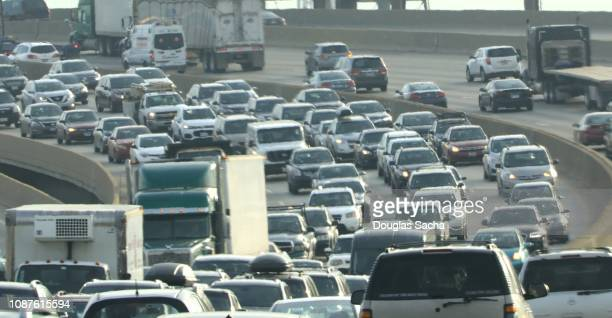 rush hour of busy traffic on the paved highway - traffic jam stock pictures, royalty-free photos & images