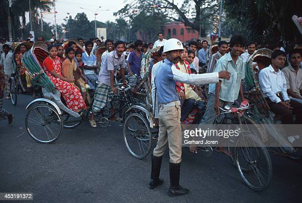 Rush hour on a street of Dhaka. The traffic mainly consists of rickshaws and bicycles.