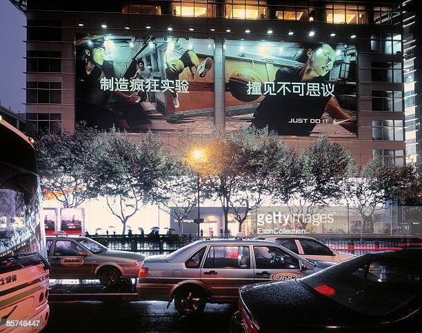 rush hour traffic and building with billboards. - shanghai billboard stock pictures, royalty-free photos & images