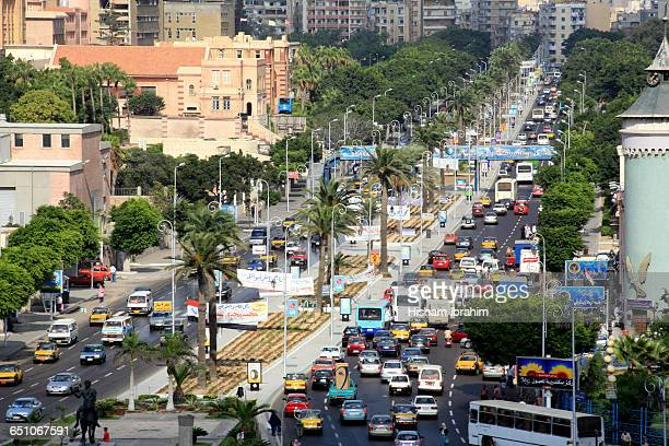 rush hour traffic downtown alexandria, egypt - egyptian culture stock photos and pictures