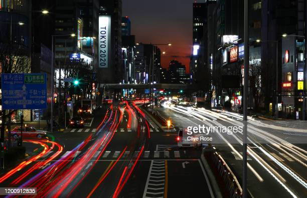 Rush hour traffic is seen passing a Tokyo 2020 promotional display in the Aoyama district of Tokyo on January 21, 2020 in Tokyo, Japan.
