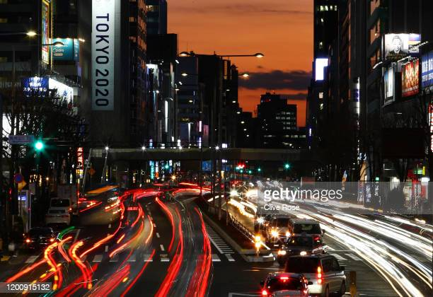 Rush hour traffic is seen passing a Tokyo 2020 promotional display in the Aoyama district of Tokyo on January 21 2020 in Tokyo Japan