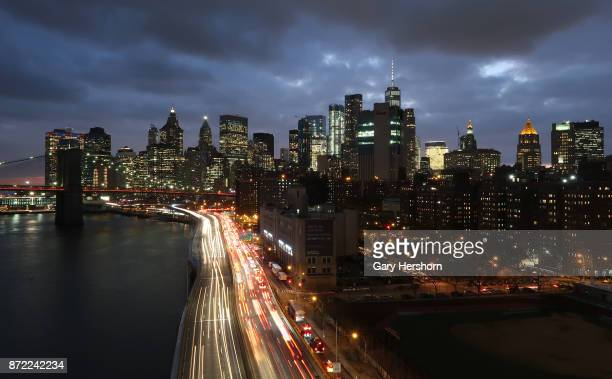 Rush hour traffic moves along on FDR Drive at sunset on the east side of Manhattan on November 8 2017 in New York City