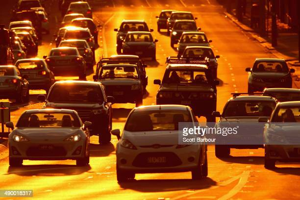 Rush hour traffic on a congested road as the sun sets on May 13 2014 in Melbourne Australia Tony Abbott's Coalition government will deliver it's...