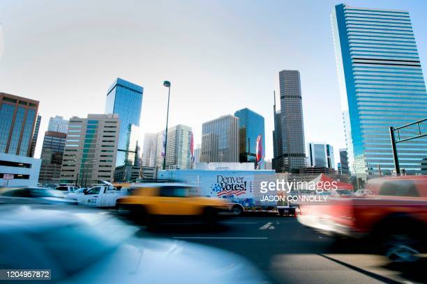 Rush hour traffic passes by the Denver Elections Divisions HaulnVote mobile trailer in Denver Colorado on Super Tuesday on March 3 2020 Fourteen...