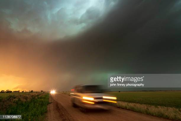 a rush of traffic trying to escape a severe hail storm kansas, usa - ominous stock pictures, royalty-free photos & images