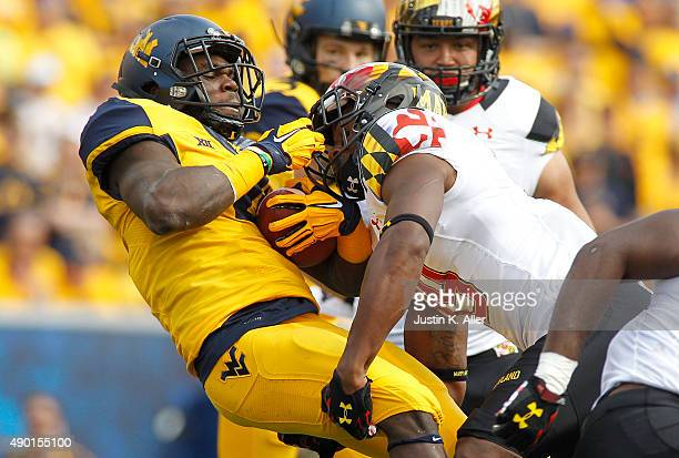 Rushel Shell of the West Virginia Mountaineers is tackled by AJ Hendy of the Maryland Terrapins in the first quarter during the game on September 26...