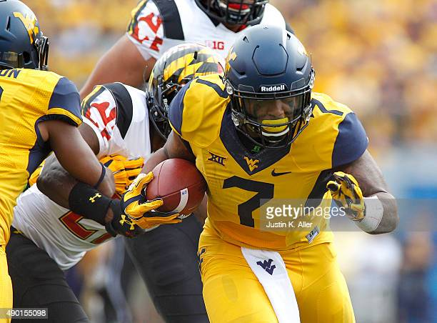 Rushel Shell of the West Virginia Mountaineers rushes during the game against the Maryland Terrapins on September 26 2015 at Mountaineer Field in...