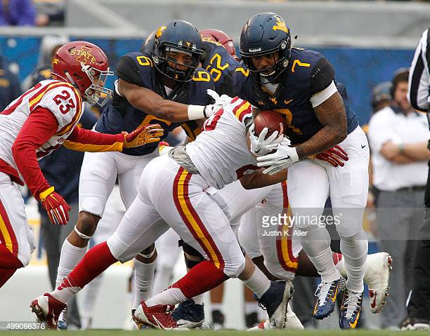 Rushel Shell of the West Virginia Mountaineers rushes in the first half during the game against the Iowa State Cyclones on November 28 2015 at...