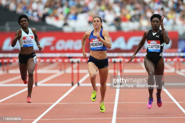 Rushell Clayton of Jamaica Zuzana Hejnova of the Czech Republic and Janieve Russell of Jamaica compete in the Women's 400m Hurdles during Day Two of...