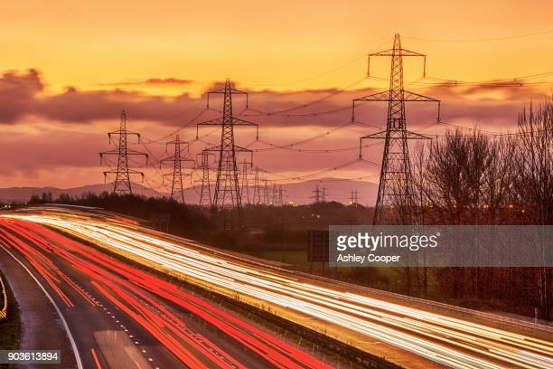 rushhour on the m56 motorway near helsby, cheshire, uk at dusk. - fuel and power generation stock pictures, royalty-free photos & images