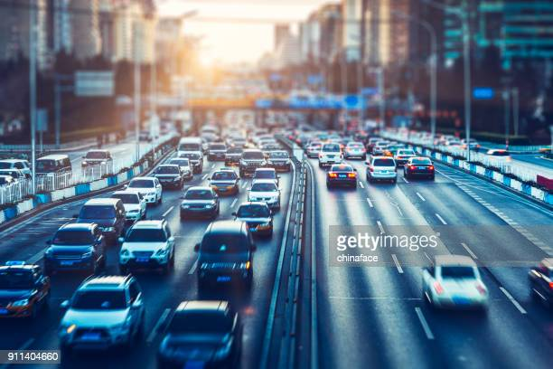 rush-hour traffic in downtown beijing - on the move stock pictures, royalty-free photos & images
