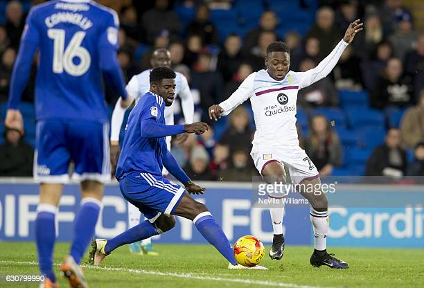 Rushian Hepburn Murphy of Aston Villa is challenged by Bruno Ecuele Manga of Cardiff City during the Sky Bet Championship match between Cardiff City...