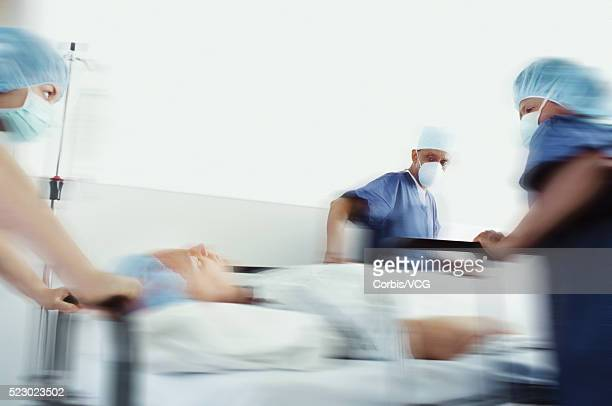 Rushing a patient to surgery