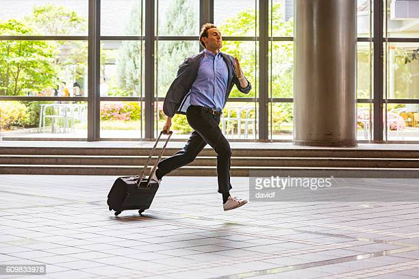 rushing business person running with a suitcase - beat the clock stock photos and pictures