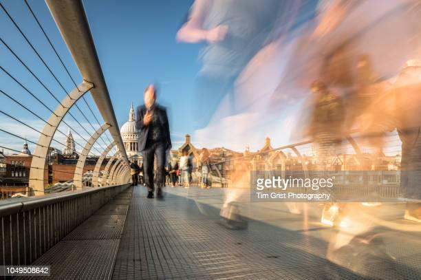 rushing commuters on the millennium bridge, london - footbridge stock photos and pictures