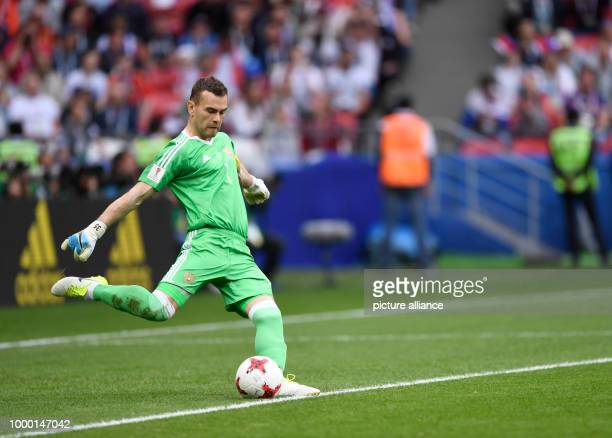 Rusian goalkeeper Igor Akinfeev takes a goal kick during the group stage match pitting Mexico against Russia at the Kazan Arena in Kazan Russia 24...
