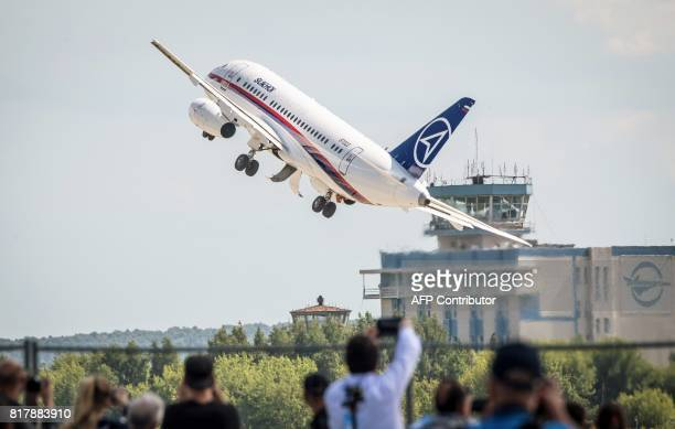 Rusian Sukhoi Superjet 100 airliner takes off for an exhibition flight on July 18, 2017 during the opening day of the annual air show MAKS 2017 in...