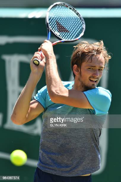 Rusia's Daniil Medvedev returns against US player Steve Johnson during their Men's singles first round match at the ATP Nature Valley International...