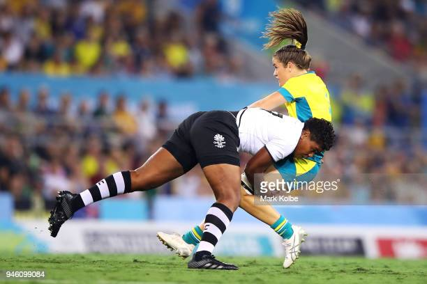 Rusila Nagasau of Fiji tackles Dom du Toit of Australia during the women's Rugby Sevens match between Australia and Fiji on day 10 of the Gold Coast...