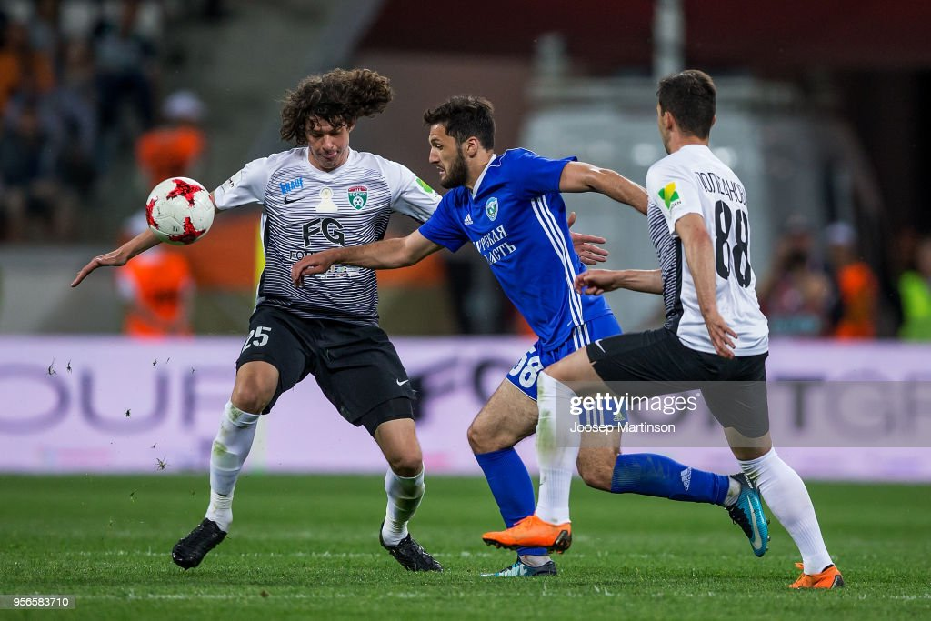 Ruslan Bolov of FC Avangard controls the ball against Andrei Buivolov of FC Tosno during Russian Cup Final match between FC Tosno and Fc Avangard at Volgograd Arena on May 9, 2018 in Volgograd, Russia.