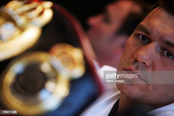 Ruslan Chagaev of Uzbekistan focusses the World champion belt during the press conference at Lindner Hotel on January 14 2008 in Duesseldorf Germany...