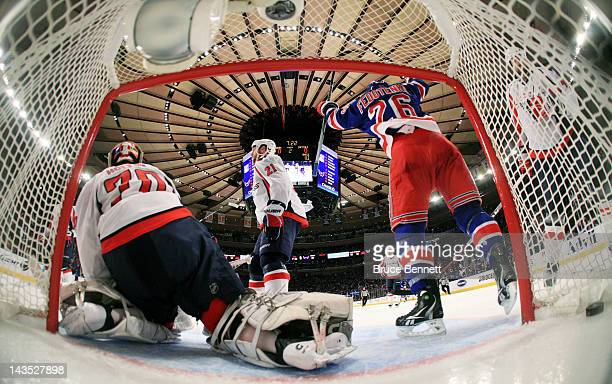 Ruslan Fedotenko celebrates a goal by teammate Artem Anisimov of the New York Rangers as Braden Holtby of the Washington Capitals reacts in the...