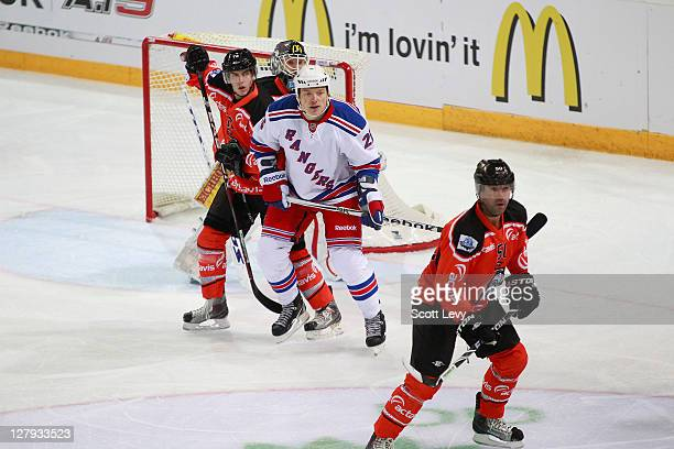 Ruslan Fedotenko of the New York Rangers battles for position in front of the net with Samuel Erni of EV Zug at the Bossard Arena during the 2011 NHL...