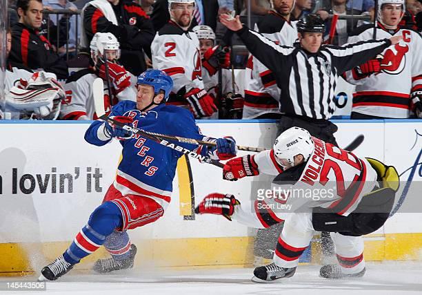 Ruslan Fedotenko of the New York Rangers skates against Anton Volchenkov of  the New Jersey Devils 878806ce3