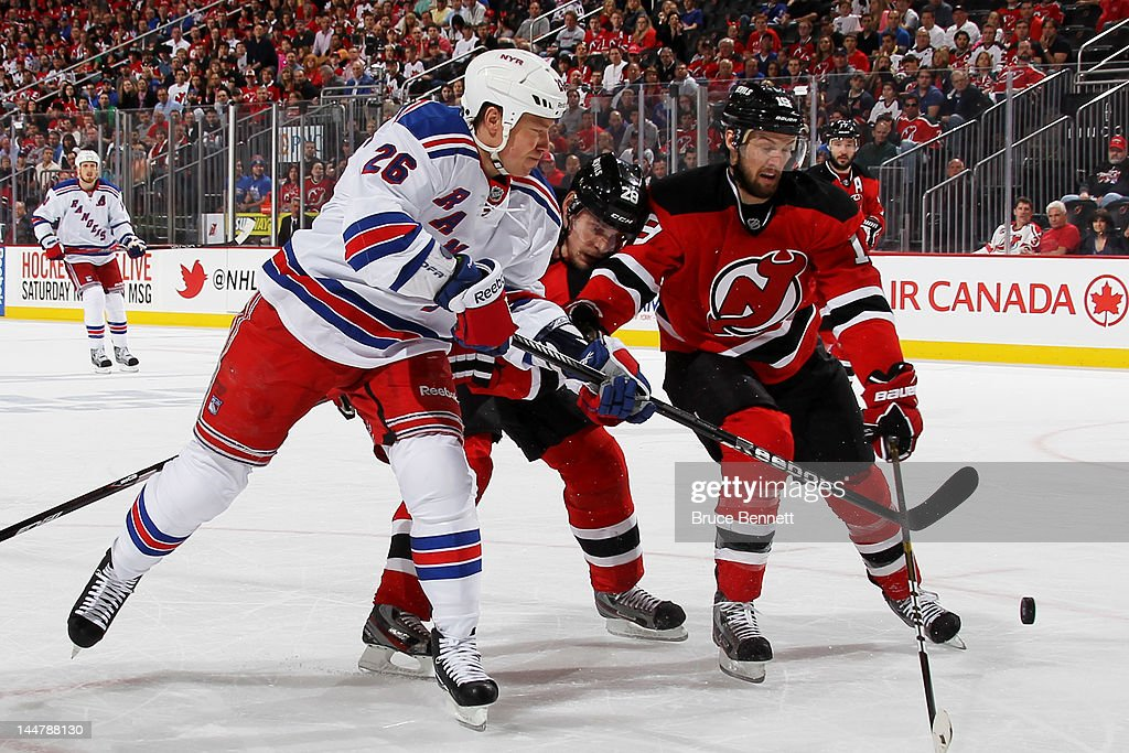 Ruslan Fedotenko  26 of the New York Rangers vies for the puck with Anton  Volchenkov e06d84f39