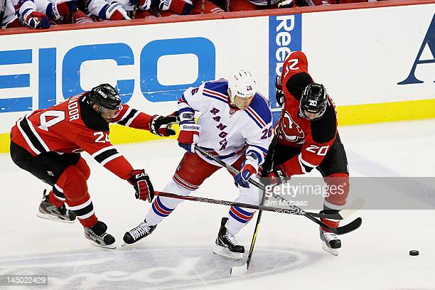 Ruslan Fedotenko of the New York Rangers vies for the puck with Ryan Carter  and Bryce 8e360cf51