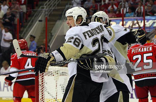 Ruslan Fedotenko of the Pittsburgh Penguins celebrates his goal against the Carolina Hurricanes during Game Four of the Eastern Conference...