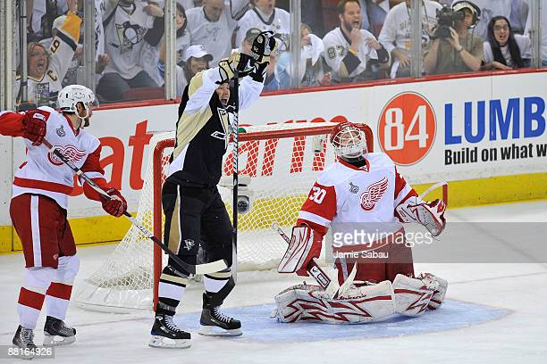 Ruslan Fedotenko of the Pittsburgh Penguins celebrates Maxime Talbot's goal in the first period past Chris Osgood of the Detroit Red Wings during...