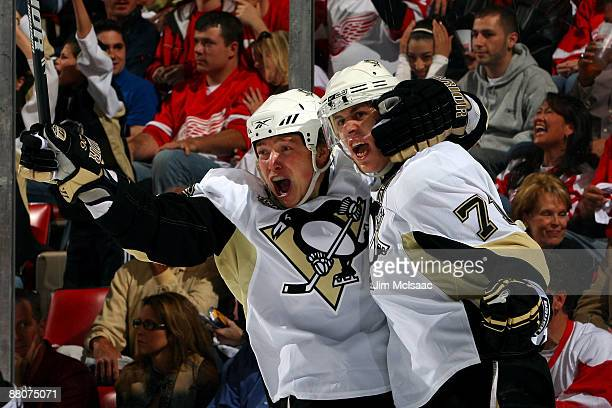 Ruslan Fedotenko of the Pittsburgh Penguins celebrates with teammate Evgeni Malkin after scoring a goal in the first period against the Detroit Red...