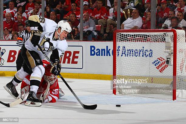 Ruslan Fedotenko of the Pittsburgh Penguins scores a goal past goalie Chris Osgood of the Detroit Red Wings during Game 1 of the 2009 Stanley Cup...