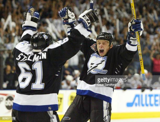 Ruslan Fedotenko of the Tampa Bay Lightning celebrates with teammate Cory Stillman after scoring the team's second goal against the Calgary Flames in...