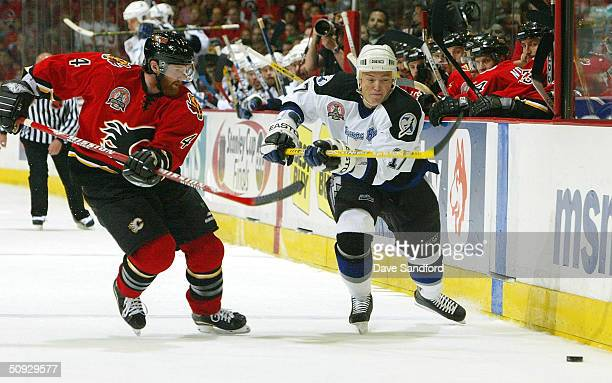 Ruslan Fedotenko of the Tampa Bay Lightning controls the puck in front of Jordan Leopold of the Calgary Flames in Game six of the 2004 NHL Stanley...