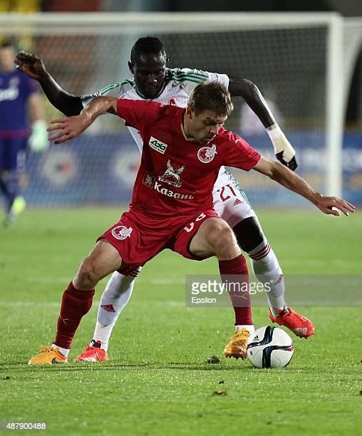 Ruslan Kambolov of FC Rubin Kazan is challenged by Baye Oumar Niasse of FC Lokomotiv Moscow during the Russian Premier League match between FC Rubin...