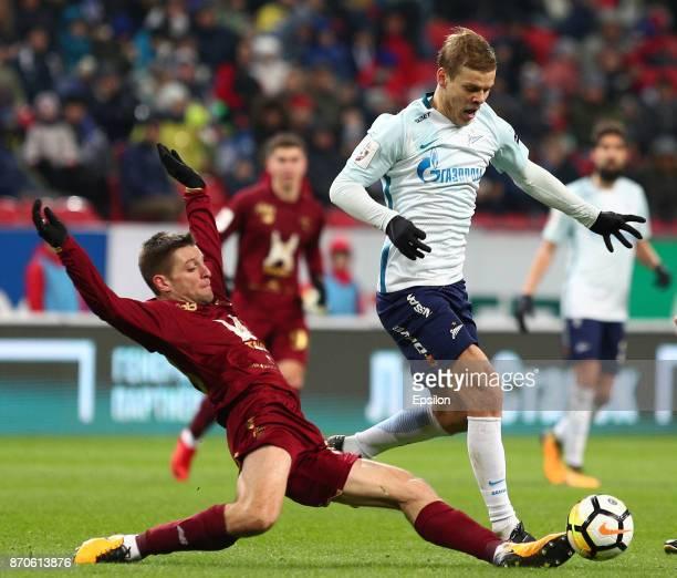 Ruslan Kambolov of FC Rubin Kazan vies for the ball with Aleksandr Kokorin FC Zenit Saint Petersburg during the Russian Premier League match between...