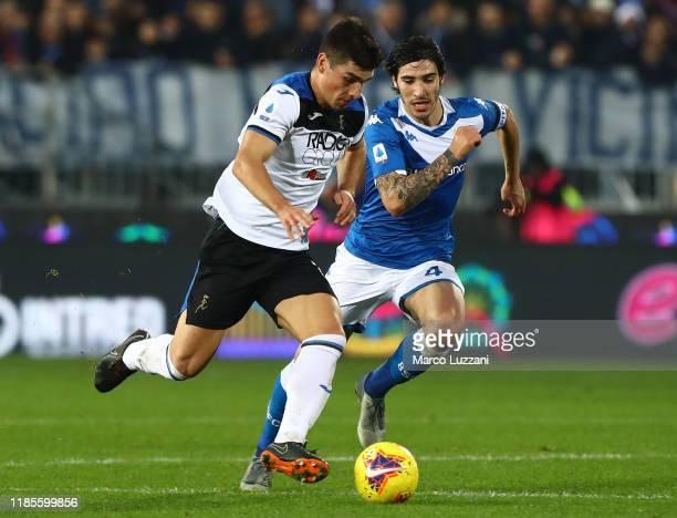 Ruslan Malinovskyi of Atalanta BC is challenged by Sandro Tonali of Brescia Calcio during the Serie A match between Brescia Calcio and Atalanta BC at...