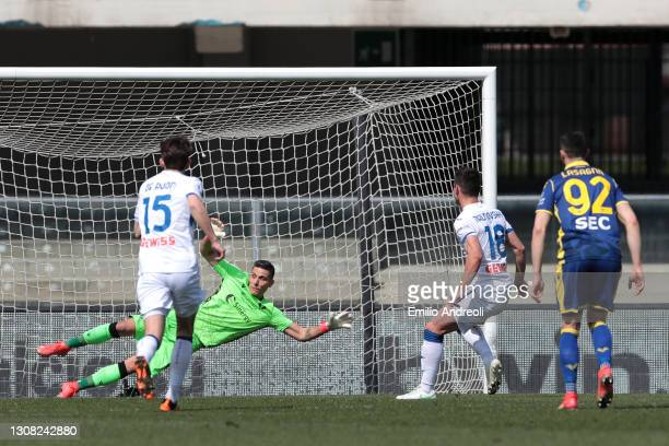 Ruslan Malinovskyi of Atalanta B.C. Scores their side's first goal past Marco Silvestri of Hellas Verona from the penalty spot during the Serie A...