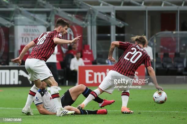 Ruslan Malinovskyi of Atalanta is fouled by Lucas Biglia of AC Milan to conceding a penalty during the Serie A match between AC Milan and Atalanta BC...