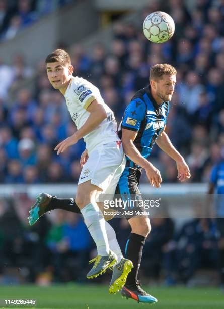 Ruslan Malinovskyi of Genk and Mats Rits of Club Brugge fight for the ball during the Jupiler Pro League playoff 1 match between Club Brugge and Krc...