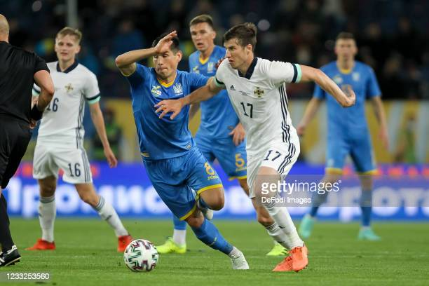 Ruslan Malinovskyi of Ukraine and Paddy Mc Nair of Northern Ireland battle for the ball during the international friendly match between Ukraine and...