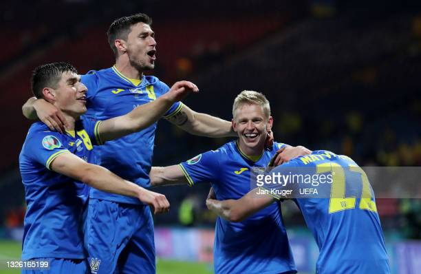 Ruslan Malinovskyi, Roman Yaremchuk and Oleksandr Zinchenko of Ukraine celebrate their side's victory after the UEFA Euro 2020 Championship Round of...