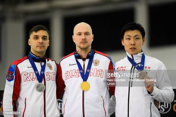 Ruslan Murashov of Russia Pavel Kulizhnikov of Russia and Tatsuya Shinhama of Japan stand on the podium after the men's 500 meter during the ISU...