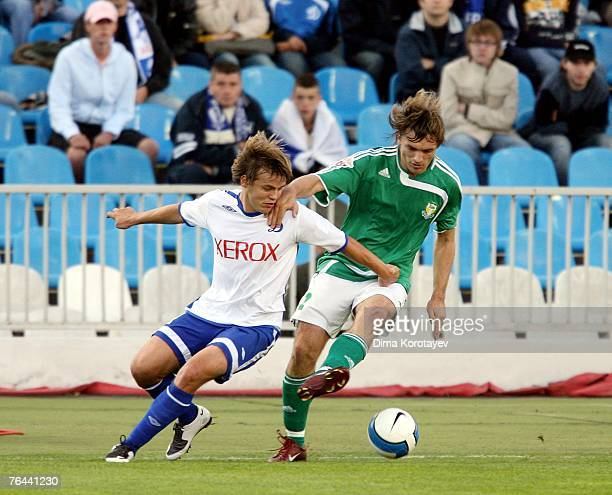Ruslan Pimenov of FC Dynamo Moscow competes for the ball with Ruslan Mostovoy of FC Tom Tomsk during the Russian Football League Championship match...