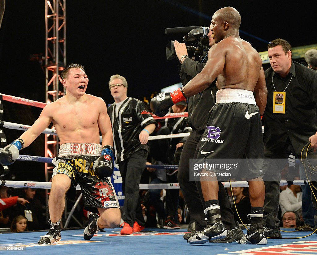 Ruslan Provodnikov (L) goes to his knees at the end of the boxing match against WBO Welterweight Champion Timothy Bradley during the WBO Welterweight Championship boxing match at The Home Depot Center on March 16, 2013 in Carson, California.