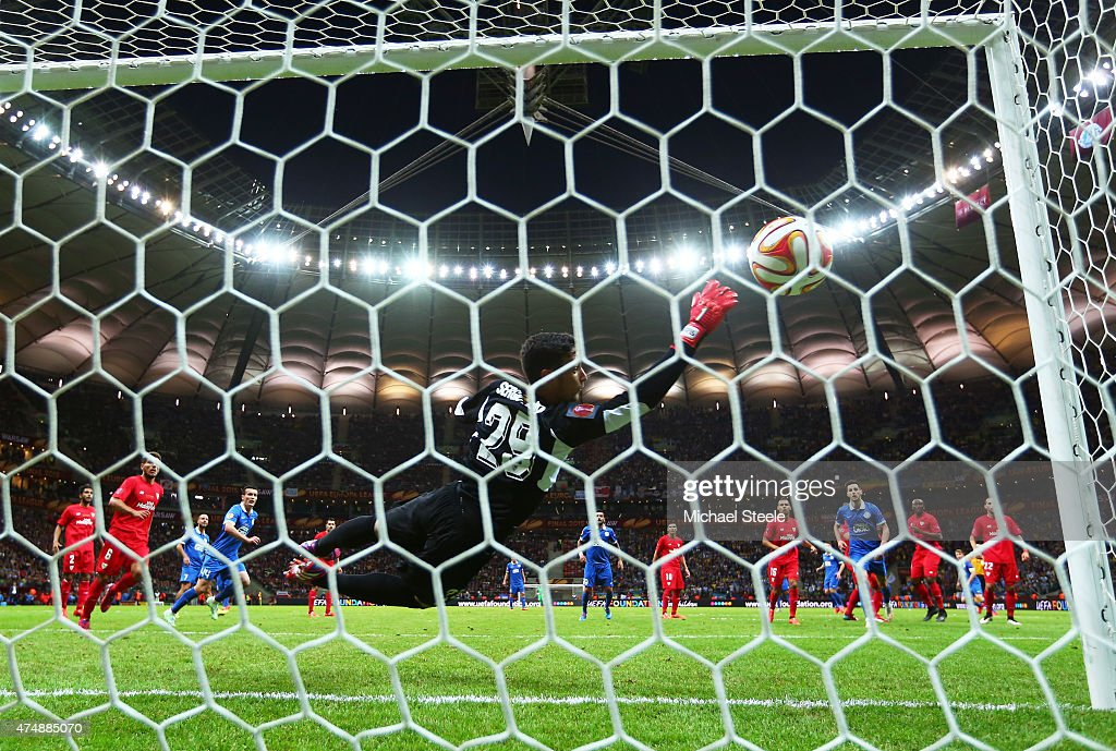 Ruslan Rotan (blocked) of Dnipro scores his team's second goal with a free kick past Sergio Rico of Sevilla during the UEFA Europa League Final match between FC Dnipro Dnipropetrovsk and FC Sevilla on May 27, 2015 in Warsaw, Poland.