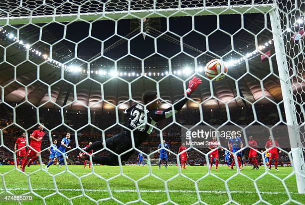 Ruslan Rotan of Dnipro scores his team's second goal with a free kick past Sergio Rico of Sevilla during the UEFA Europa League Final match between...